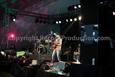 musician playing guitar at gig  - www.RecordProduction.com