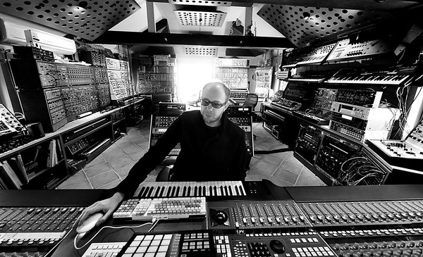 Tom Rowlands of the Chemical Brothers at his private recording studio in England.  Tom is seen here with his enormous collection of synths and SSL Duality mixing console.