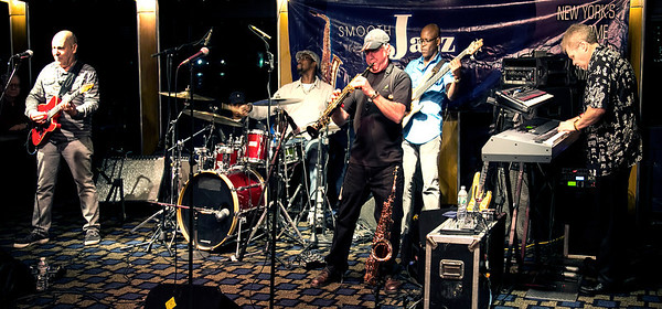 Spyro Gyra - Jazz Cruise around NYC - August 14, 2013. Band includes Jay Beckenstein, Lee Pearson - drums, Scott Ambush - bass, Tom Schuman - keyboard (original band member), Julio Fernandez - guitar (since 1984). Shot with no flash at high ISO - processed using denoise software.