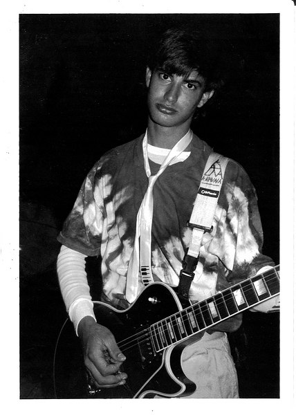 "Sweet Sixteen for the Sweet Sixteen<br /> Botanical Gardens in City Park, New Orleans, Louisiana<br /> Pre-dating MTV's ""My Sweet 16"", sixteen Domincan girls hire us to play for their huge party. Looks like I've had just about enough of the professional photographer. Too bad it's in black and white - my tie-dye plays beautifully against my bright green Duckheads. Not to mention my powder-blue satin piano tie."