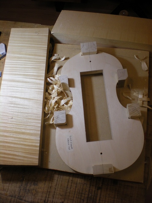 This shows the mold with the wood that will be used for the instrument - maple (on the left) for the ribs and back and spruce for the top.