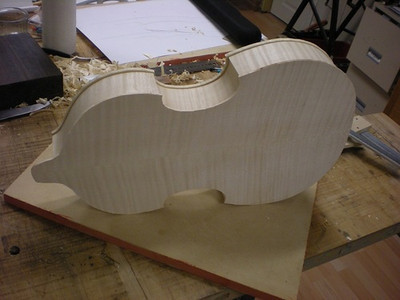 Since the viola d'amore typically has plate edges that align with the ribs, (without the usual overhang seen on violin family instruments) it is now that the plate edges can be finished to match the ribs and the purfling can be put in the top.