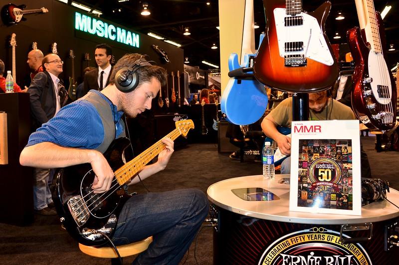 San Diego musician Ben Barnes, testing out a new 2012 model Ernie Ball bass guitar.