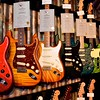 An overwhelming display of Guitars at the Fender, Inc. display.