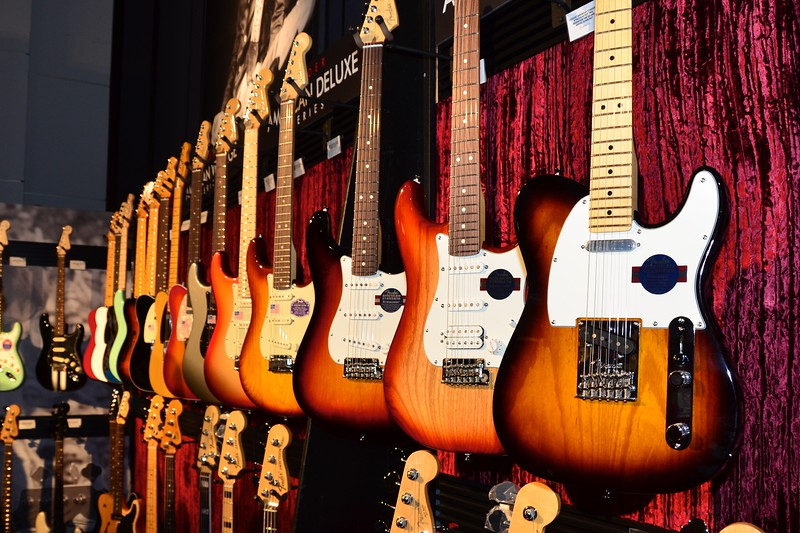 Another overwhelming display of guitars at the Fender, Inc. display.