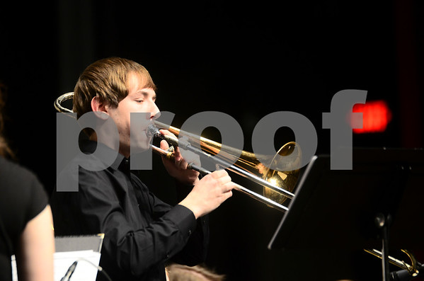 -Messenger photo by Jesse Major<br /> <br /> Jeremy Knudson, a senior at Fort Dodge Senior High, plays a trombone solo at the North Central Iowa Bandmasters Jazz Festival Saturday.