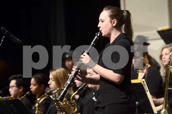 -Messenger photo by Jesse Major<br /> <br /> Ashley Richardson, a senior at Webster City High School, plays a clarinet solo at the North Central Iowa Bandmasters Jazz Festival Saturday.