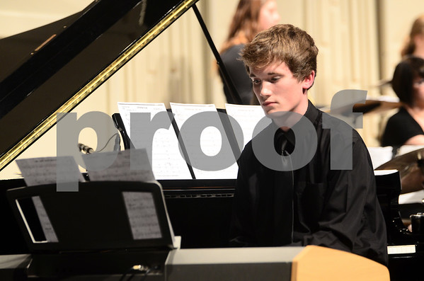 -Messenger photo by Jesse Major<br /> <br /> Hankel Haldin, a junior at Fort Dodge Senior HIgh, plays the keyboard at the North Central Iowa Bandmasters Jazz Festival Saturday.
