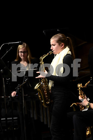 -Messenger photo by Jesse Major<br /> <br /> Emma Nelson, a sophomore at Manson Northwest Webster High School, plays a saxophone solo at the North Central Iowa Bandmasters Jazz Festival Saturday.