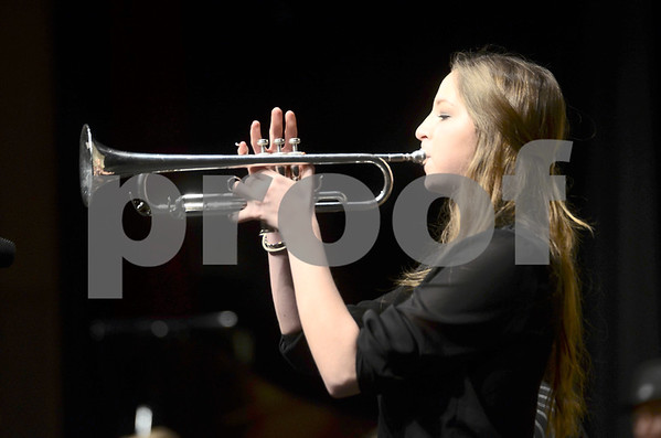 -Messenger photo by Jesse Major<br /> <br /> Cassidy Janssen, a junior at Webster City High School, plays a trumpet solo during the North Central Iowa Bandmasters Jazz Festival Saturday.