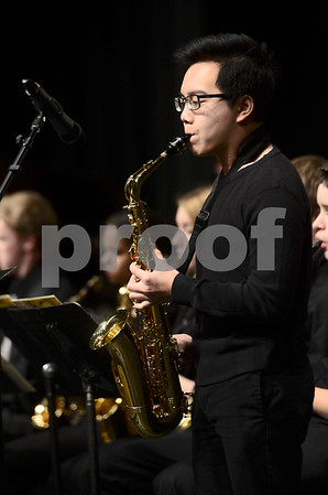 -Messenger photo by Jesse Major<br /> <br /> Demetry Thongsuk, a senior at Webster City High School, plays a saxophone solo during the North Central Iowa Bandmasters Jazz Festival Saturday.