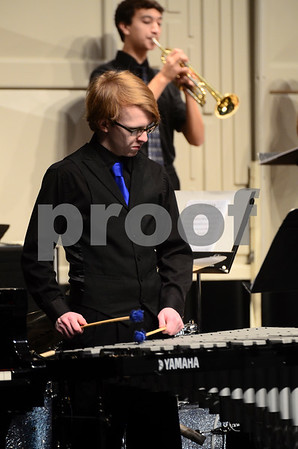 -Messenger photo by Jesse Major<br /> <br /> Mike Miller, a sophomore at Humboldt High School, plays in the school's jazz band at the North Central Iowa Bandmasters Jazz Festival Saturday.