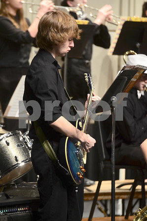-Messenger photo by Jesse Major<br /> <br /> Chris Anderson, a junior at Webster City High School, plays guitar in the school's jazz band at the North Central Iowa Bandmasters Jazz Festival Saturday.