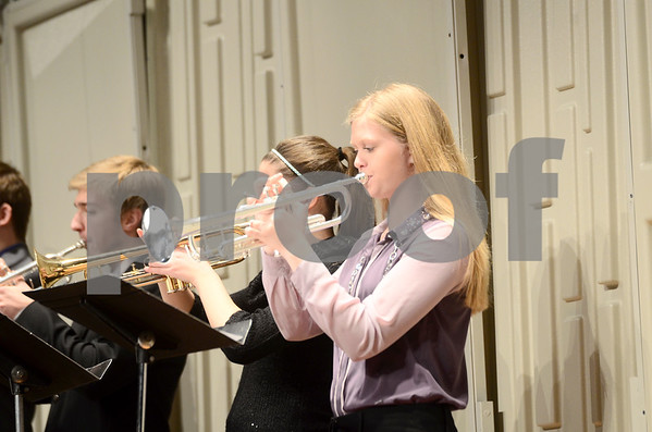 -Messenger photo by Jesse Major<br /> <br /> Rebecca Hommez, a freshman at Algona High School, plays trumpet with the school's jazz band at the North Central Iowa Bandmasters Jazz Festival Saturday.