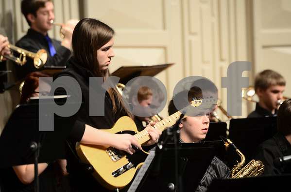 -Messenger photo by Jesse Major<br /> <br /> Amanda Ferry, a sophomore at Humboldt High School, plays guitar in the school's jazz band at the North Central Iowa Bandmasters Jazz Festival Saturday.