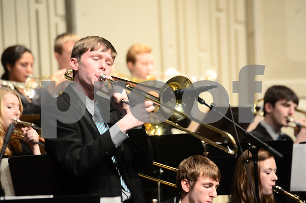 -Messenger photo by Jesse Major<br /> <br /> Liam McDermott, a junior at Southeast Valley High School, plays a trombone solo at the North Central Iowa Bandmasters Jazz Festival Saturday.
