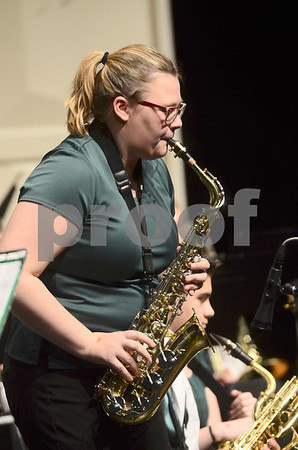 -Messenger photo by Jesse Major<br /> <br /> Rose Touney, a senior at St. Edmond High School performs a saxophone solo at the North Central Iowa Bandmasters Jazz Festival Saturday.