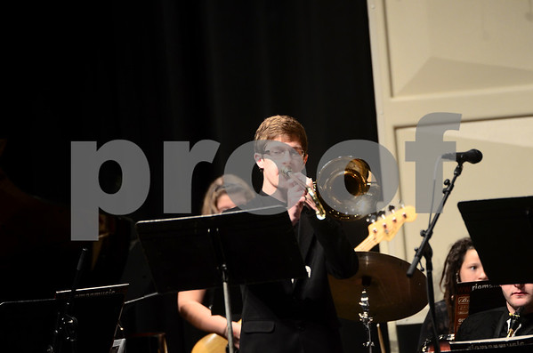 -Messenger photo by Jesse Major<br /> <br /> Noah Larson, a junior at Manson Northwest Webster High School, plays a trombone solo at the North Central Iowa Bandmasters Jazz Festival Saturday.
