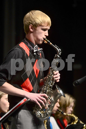 -Messenger photo by Jesse Major<br /> <br /> Danny Illg, a senior at Algona High School, plays a saxophone solo during the North Central Iowa Bandmasters Jazz Festival Saturday.
