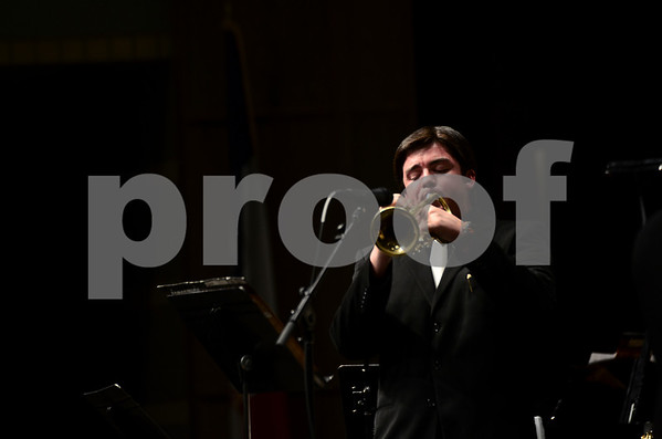 -Messenger photo by Jesse Major<br /> <br /> Josh Neumann, a junior at Manson Northwest Highschool, plays a trumpet solo at the North Central Iowa Bandmasters Jazz Festival Saturday.