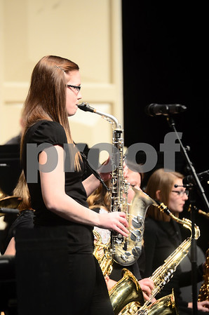 -Messenger photo by Jesse Major<br /> <br /> Brittany Eger, a junior at Fort Dodge Senior High, plays a saxophone solo at the North Central Iowa Bandmasters Jazz Festival Saturday.