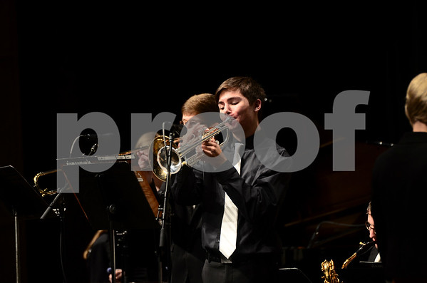 -Messenger photo by Jesse Major<br /> <br /> Hunter Johnson, a sophomore at Manson Northwest Webster High School, plays a trumpet solo at the North Central Iowa Bandmasters Jazz Festival Saturday.