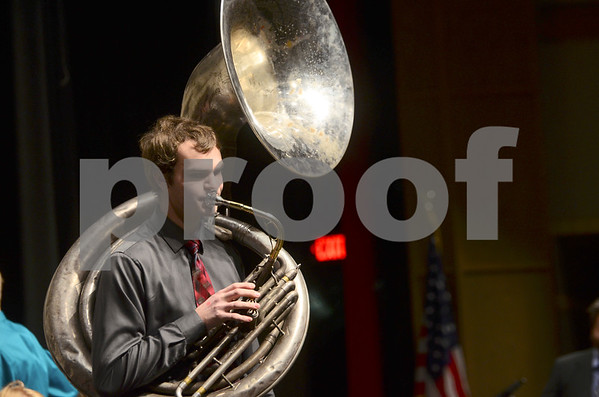 -Messenger photo by Jesse Major<br /> <br /> Adam Denner, a junior at Algona High School, plays a sousaphone solo during the North Central Iowa Bandmasters Jazz Festival Saturday.