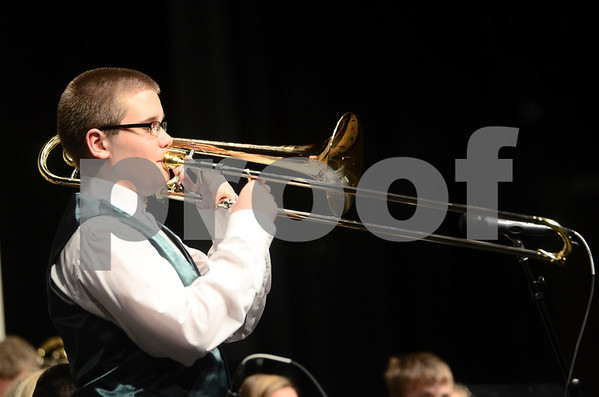 -Messenger photo by Jesse Major<br /> <br /> Max Wallace, a sophomore at St. Edmond High School, performs a trombone solo at the North Central Iowa Bandmasters Jazz Festival Saturday.