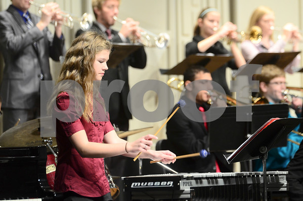 -Messenger photo by Jesse Major<br /> <br /> Anna Cox, a freshman at Algona High School, plays vibes with the school's jazz band at the North Central Iowa Bandmasters Jazz Festival Saturday.