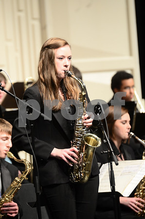 -Messenger photo by Jesse Major<br /> <br /> Allison Carlon, a junior at Southeast Valley High School, plays a saxophone solo at the North Central Iowa Bandmasters Jazz Festival Saturday.