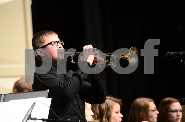 -Messenger photo by Jesse Major<br /> <br /> Alex Graham, a junior at Fort Dodge Senior High, plays a trumpet solo at the North Central Iowa Bandmasters Jazz Festival Saturday.