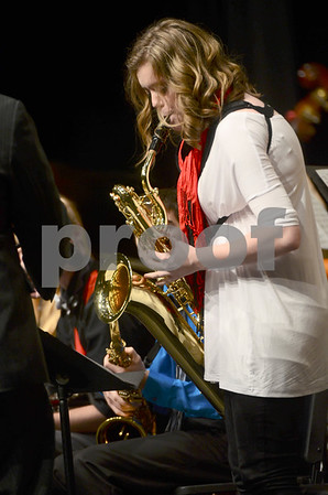 -Messenger photo by Jesse Major<br /> <br /> Maddie Roach, a senior at Algona High School, performs a saxophone solo during the North Central Iowa Bandmasters Jazz Festival Saturday.