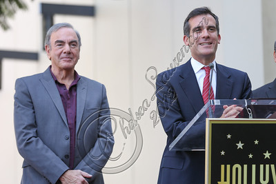 HOLLYWOOD, CA - AUGUST 10:  Singer Neil Diamond (L) and councilman Eric Garcetti (R) attend Neil Diamond's Hollywood Walk of Fame ceremony on August 10, 2012 in Hollywood, California.  (Photo by Chelsea Lauren/WireImage)