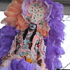 Member of Big Chief Walter Cook & The Creole Wild West Mardi Gras Indians performs at the Jazz & Heritage Stage first weekend of NOLA Jazz Fest 2011