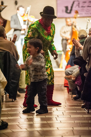 The youngest member of the audience dances with one of the oldest.