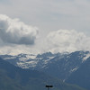 Shot of the mountains and clouds from the venue doors.   I couldn't quite get rid of the parking lot light posts.