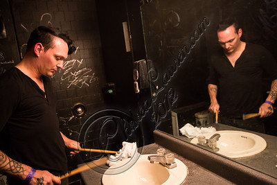 WEST HOLLYWOOD, CA - SEPTEMBER 23:  Drummer Jamie Miller of Orgy prepares backstage at The Roxy Theatre on September 23, 2012 in West Hollywood, California.  (Photo by Chelsea Lauren/WireImage)