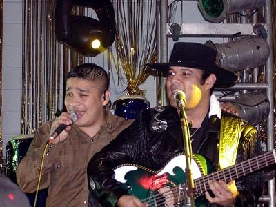 Siggno's Jesse Turner singing onstage with Los Palominos