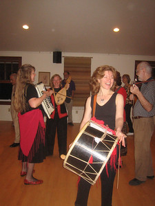 Melinda, Flora (playing gadulka), Helen (tupan), and guest musician Dean (tambura) playing at Whately Dance Barn, April 15, 2006