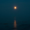 (....moonrise over a misty sea)