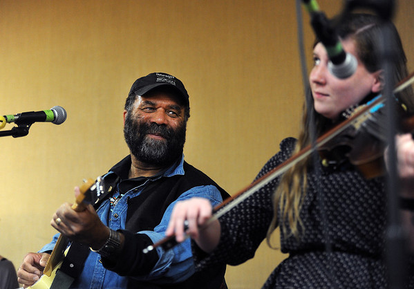 "Otis Taylor, left, listens to Brady Gaynor play the violin during a jam session at the Saturday workshop.<br />  Blues artist, Otis Taylor, in his home town of Boulder, is hosting the Trance Blues Jam Festival. Unlike traditional music festivals where the audience is generally expected to be a semi-passive participant, the Trance Blues Jam Festival (TBJF) encourages people to be active participants who join together in the creation of music. For more photos and a video, go to  <a href=""http://www.dailycamera.com"">http://www.dailycamera.com</a>.<br /> Cliff Grassmick  / November 24, 2012"