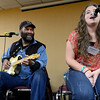 "Otis Taylor, left, listens to Gabriela Silk sing during a jam session at the Saturday workshop. <br /> Blues artist, Otis Taylor, in his home town of Boulder, is hosting the Trance Blues Jam Festival. Unlike traditional music festivals where the audience is generally expected to be a semi-passive participant, the Trance Blues Jam Festival (TBJF) encourages people to be active participants who join together in the creation of music. For more photos and a video, go to  <a href=""http://www.dailycamera.com"">http://www.dailycamera.com</a>.<br /> Cliff Grassmick  / November 24, 2012"