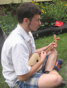 Lysander singing a Georgian song and playing a panduri, one of the instruments he acquired this summer in Georgia.