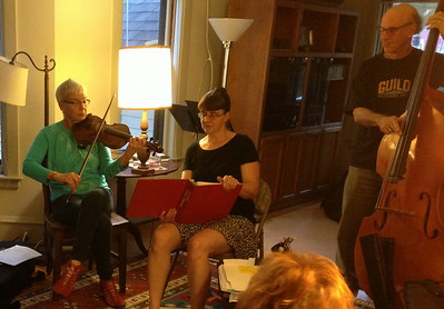 Meanwhile, in the living room, Jenny and Kitty were singing songs, accompanied by Joe and others as the evening progressed.