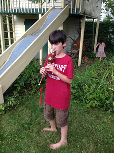 Our neighbor Kiernan played another Chinese instrument which Ken had given him in a previous year. He now can play tunes on this Hulusi, a free-reed wind instrument with three bamboo pipes which pass through a gourd wind chest; one pipe has finger holes and the other two are drone pipes.