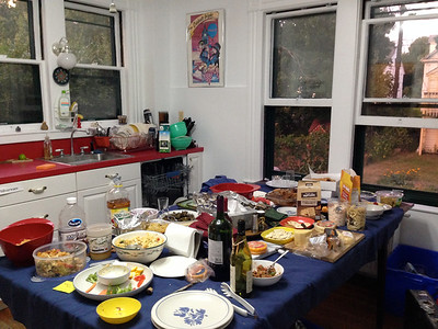 Potluck food and drink. PLENTY of food!   Note the poster on our kitchen wall (see close-up, next photo...)