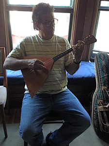 I handed my old Balalaika to one of our guests, a guitarist from Puerto Rico. He was curious to try it.