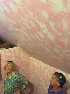 Touring the house with Christine and Jon, who remember the teenager who   chose pink for this attic room.