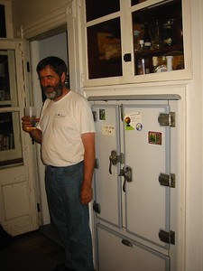 Ken stands by the old Kelvinator refrigerator which we had filled with ice and cold drinks. (1st time we've tried to return this cabinet to its original purpose)