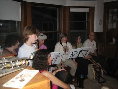 All ages making music together. Dinah, Raphael (oboe reed in mouth), Dina, Barb, Karen, Barbara, Joe.